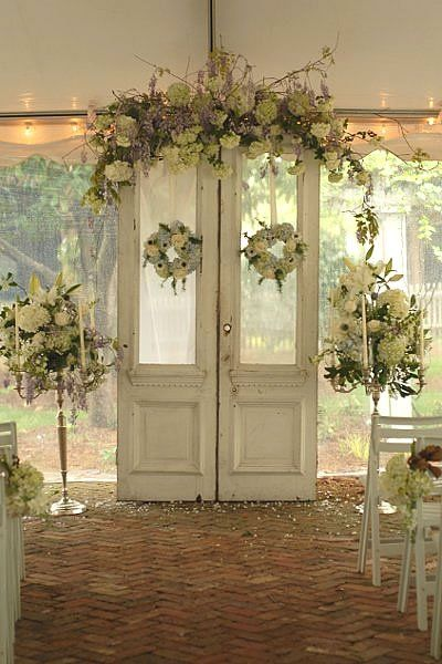 Lace or fabric curtains create an elegant backdrop. Perfect for a classic or romantic styled wedding. & Beautiful wedding ceremony backdrop ideas |
